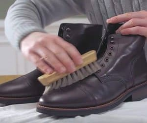 polishing a boot