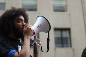 man talking in Pyle megaphone