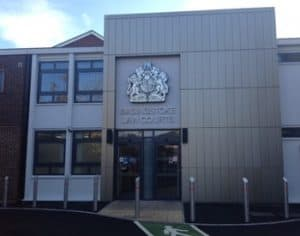 Read more about the article Man charged with causing grievous bodily harm, punches security guard in court dock